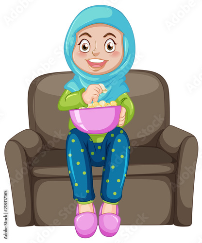 Canvas Kids A muslim girl eating popcorn
