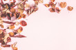 Leinwanddruck Bild - Autumn composition. Frame made of autumn flowers and leaves on pastel pink background. Flat lay, top view, copy space