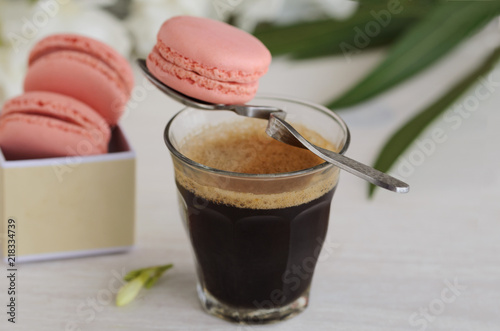 Plexiglas Macarons .Black coffee and macarons in box with flowers.Good Morning concept..