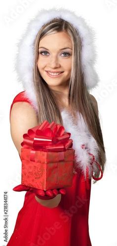 Leinwanddruck Bild Beautiful blonde woman in Santa hat with gift