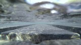 Submerged in a Modern Water Fountain - 218373947