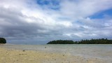 Timelapse with nice clouds moving above wild beach in Nioutoputapu island in Kingdom of Tonga - 218374746