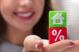 Businesswoman Holding Green And Red Cubic Blocks - 218378529