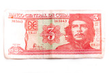 Front image of a Cuban banknote of three pesos with the image of Che Guevara on a white background