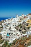 Most Romantic Greek Oia town on Santorini island, Greece. Traditional and famous houses and churches with blue domes over the Caldera, Aegean sea. Santorini classically Thera and officially Thira. - 218405114