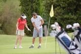 teaching a friend to play golf