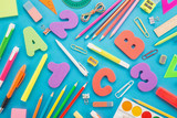 School supplies on a blue background - 218417978