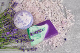 Essential lavender salt, soap and bath bomb with flowers top view. SPA lavender products.Top view, copy space