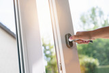 hand open white plastic pvc window at home - 218424532