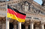 Germany Politics Concept: German Flag In Front of The Reichstag Building In Berlin, Germany With Dedication Dem Deutschen Volke, Meaning To The German People - 218432990