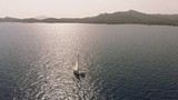 Sailing yacht on the sea near the coast, in shallow waters - 218441726
