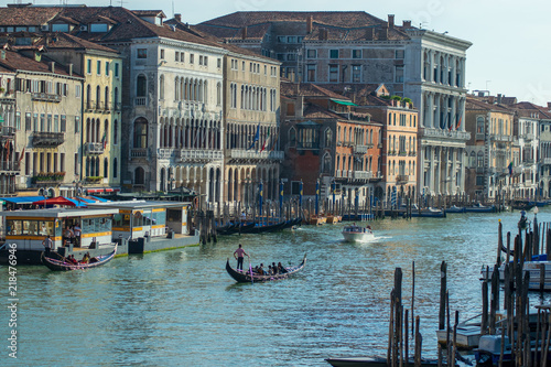 View of canal grande seen from the rialto Bridge, docked boats and architecture in Venice Italy