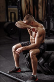 emotional bodybuilder wiping his tears. emotion and feeling concept