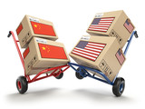USA China economic trade war market conflict concept.  Two opposing hand trucks and cardboard boxes with USA and China flags., - 218503354