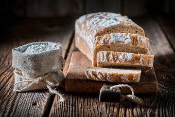 Closeup of fresh bread with whole grains on wooden table