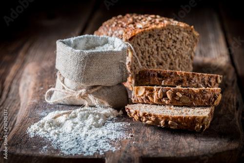 Fototapeta Healthy loaf of bread with flour for breakfast