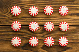 Neat rows of red and white starlight candies - 218523920
