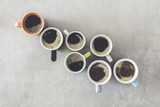 Many cups of coffee on table