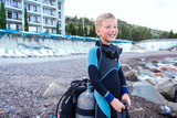.boy in a suit for diving - 218543114