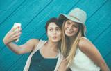 Friends having fun against blue background - 218581162