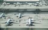 Aerial view of parked airplanes in the airport terminal. - 218584731