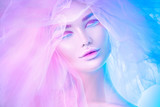 Fashion art portrait model woman in colorful bright neon lights posing, portrait of beautiful fantasy girl, trendy make-up and colourful tulle hairdo - 218591176