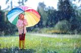 Happy Child With Rainbow Umbrella Under Rain - 218596318