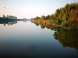Calm river in beautiful sunrise, green natural lanscape.