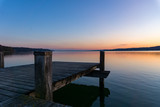 Pier in the evening light at lake Starnberger See in Bavaria