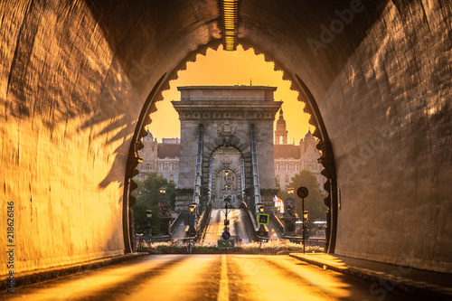 Budapest, Hungary - Entrance of the Buda Castle Tunnel at sunrise with Szechenyi Chain Bridge and Academy of Science building at background