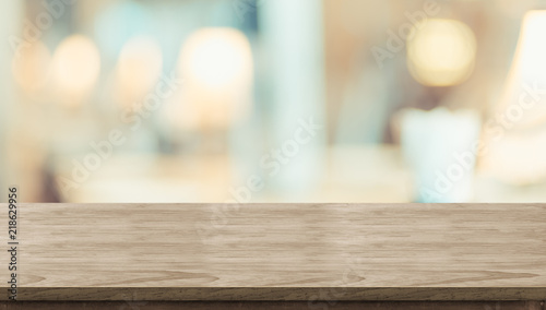 Empty rustic wood table and blurred soft light table in restaurant with bokeh background. product display template.Business presentation. - 218629956