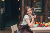 Young girl eating - 218639747
