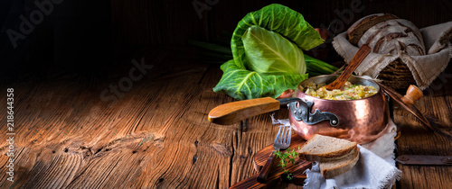 young and fresh cabbage cooked with bacon cubes - 218644358