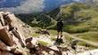 Alone hiker photographer walking rocky mountains