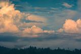 Majestic yellow clouds at sunset light