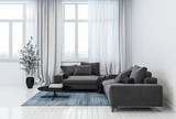 Modern living room containing sofas and plant pot