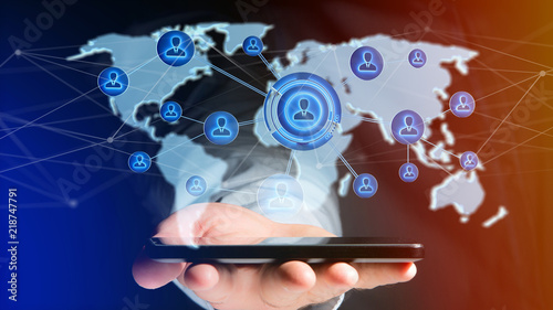 Businessman using a smartphone with a Network over a connected world map - 3d render