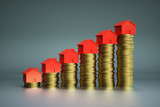 Houses on stack of coins - 218761387