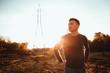 Leinwanddruck Bild - portrait of a guy in the field on a sunset background