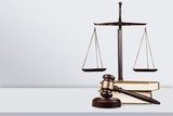 Justice Scales and books and wooden gavel - 218773140
