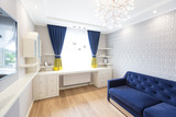 Modern living room interior design with blue sofa and a big window - 218786337