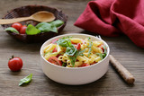 salad with pasta penne with tomatoes and arugula