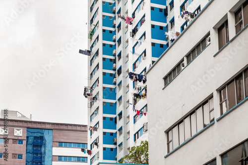 Usual life in Singapore - building with linen and clothes hung out from windows to dry.