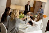 Young friends having dinner at home and toasting with white wine - 218807759