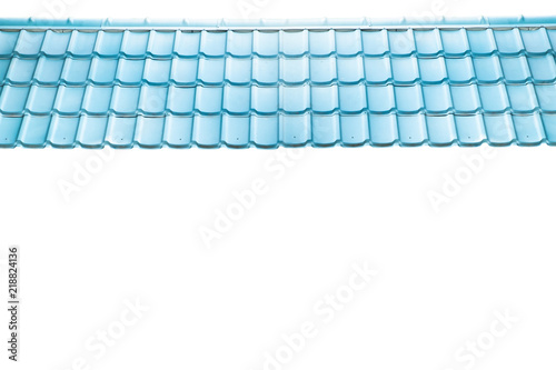 texture of bright right blue tile roof surface. isolated on white background. © Rattasak