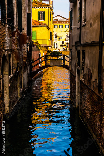 Venice, Veneto, Italy - A view from the Grand Canal in a narrow side canal on a beautiful day in October.
