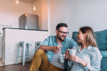 Couple drinking coffee at home.