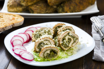 pork roulades stuffed with spinach sprinkled with freshly grated horseradish
