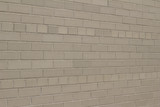 Angle view of a vintage gray brick wall background in American bond pattern with a weathered grunge look