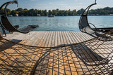 Hammock hanging on balcony in wooden house - 218852945